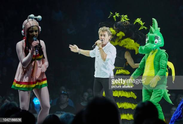 Singers Charlotte Klausner as Snail , Peter Maffay and actress Sophia Schoenert as Tabaluga on stage during the premiere of Peter Maffay's rock...