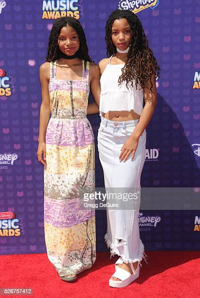 Singer's Chloe Bailey and Halle Bailey arrive at the 2016 Radio Disney Music Awards at Microsoft Theater on April 30 2016 in Los Angeles California