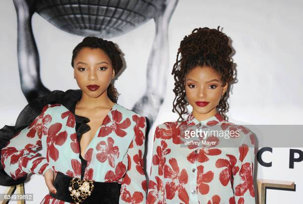 Singers Chloe Bailey and Halle Bailey arrive at the 48th NAACP Image Awards at Pasadena Civic Auditorium on February 11 2017 in Pasadena California