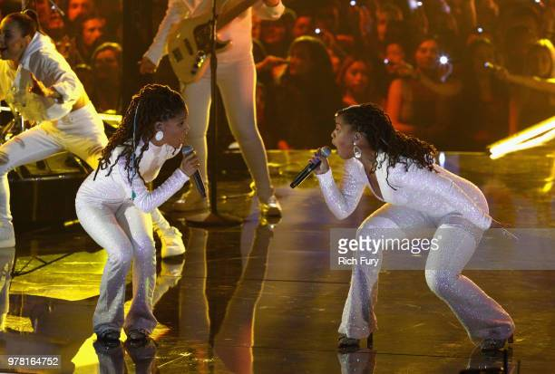 Singers Chloe x Halle perform onstage during the 2018 MTV Movie And TV Awards at Barker Hangar on June 16 2018 in Santa Monica California