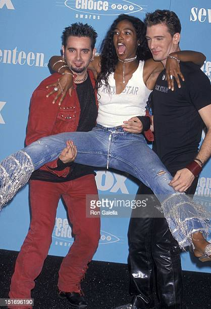 Singers Chris Kirkpatrick and JC Chasez of NSYNC and MTV VJ Ananda Lewis attend the Second Annual Teen Choice Awards on August 6 2000 at the Barker...