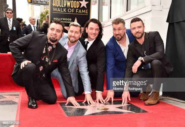Singers Chris Kirkpatrick Lance Bass JC Chasez Joey Fatone and Justin Timberlake of NSYNC are honored with a star on the Hollywood Walk of Fame on...