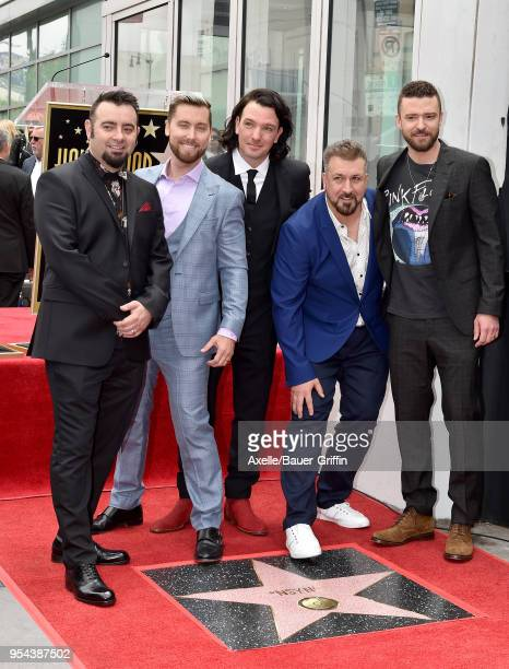 Singers Chris Kirkpatrick, Lance Bass, JC Chasez, Joey Fatone and Justin Timberlake attend the ceremony honoring NSYNC with star on the Hollywood...