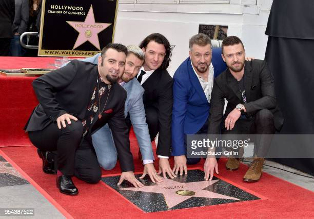 Singers Chris Kirkpatrick Lance Bass JC Chasez Joey Fatone and Justin Timberlake attend the ceremony honoring NSYNC with star on the Hollywood Walk...