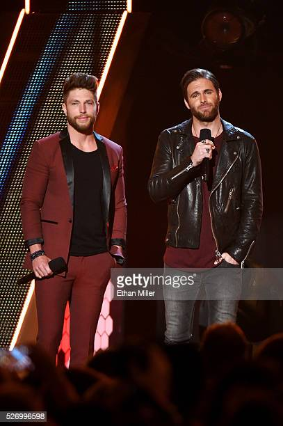 Singers Chris Lane and Canaan Smith speak onstage during the 2016 American Country Countdown Awards at The Forum on May 1 2016 in Inglewood California