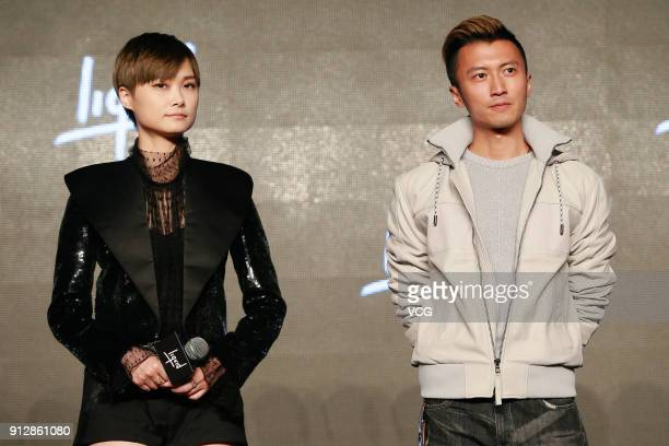 Singers Chris Lee and Nicholas Tse attend a news conference after Chinese internet giant Tencent and Sony Music Entertainment signing distribution...