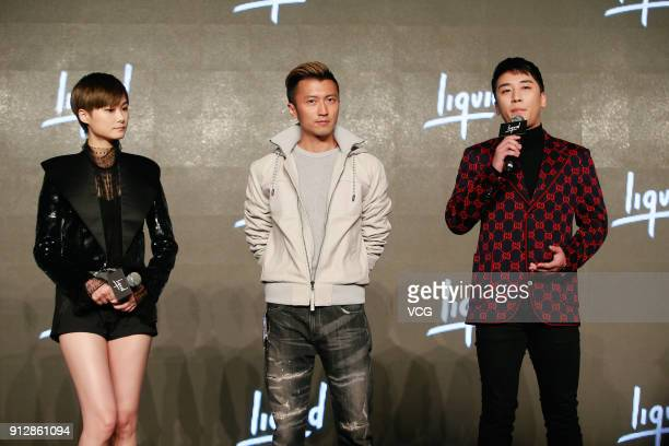 Singers Chris Lee Nicholas Tse and SeungRi attend a news conference after Chinese internet giant Tencent and Sony Music Entertainment signing...
