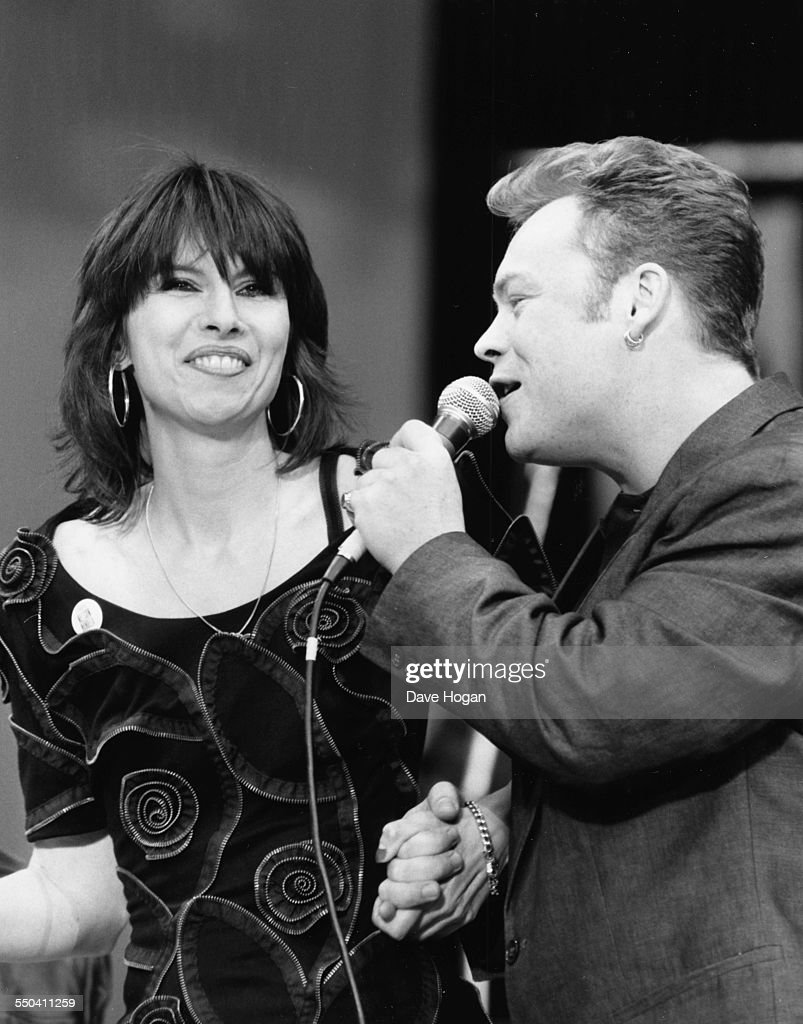 Singers Chrissie Hynde and Ali Campbell, with his band UB40, performing together at the Nelson Mandela 70th birthday tribute concert, at Wembley Stadium, London, June 13th 1988.