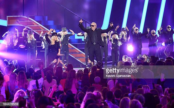 Singers Christina Aguilera and Pitbull perform onstage during Nickelodeon's 26th Annual Kids' Choice Awards at USC Galen Center on March 23 2013 in...