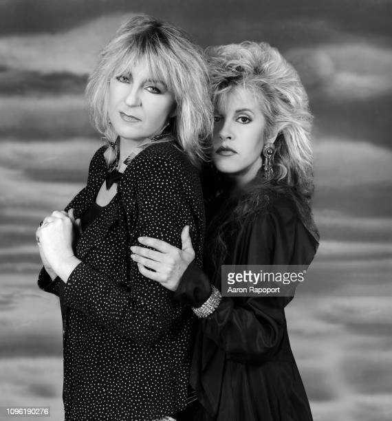 Singers Christine McVie and Stevie Nicks of Fleetwood Mac pose for a portrait circa 1987 in Los Angeles California