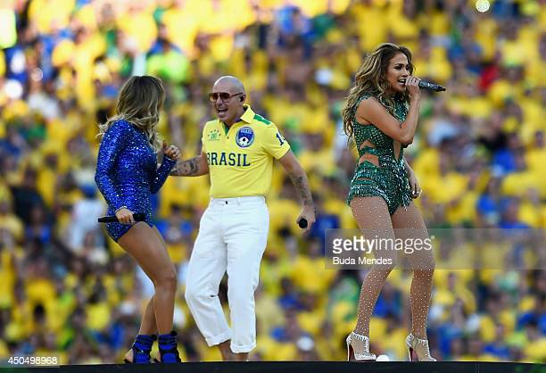 Singers Claudia Leitte, Jennifer Lopez and Pitbull perform during the Opening Ceremony of the 2014 FIFA World Cup Brazil prior to the Group A match...