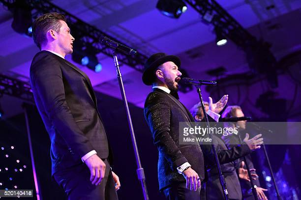 Singers Clifton Murray Victor Micallef Remigio Pereira and Fraser Walters of The Tenors perform onstage during Muhammad Ali's Celebrity Fight Night...