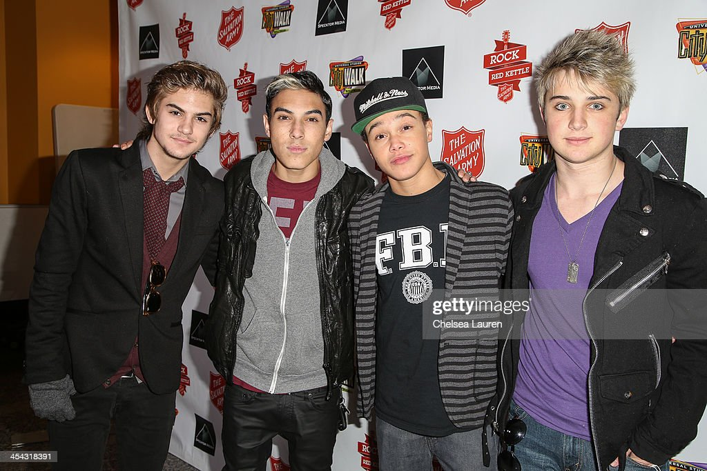 Singers Cole Pendery, Gabe Morales, Dana Vaughns and Dalton Rappatoni of IM5 arrive at The Salvation Army's 4th annual Rock The Red Kettle concert at 5 Towers Outdoor Concert Arena on December 7, 2013 in Universal City, California.