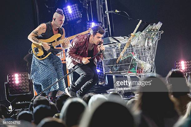 Singers Cole Whittle and Joe Jonas of DNCE perform in concert at the Frank Erwin Center on June 17 2016 in Austin Texas