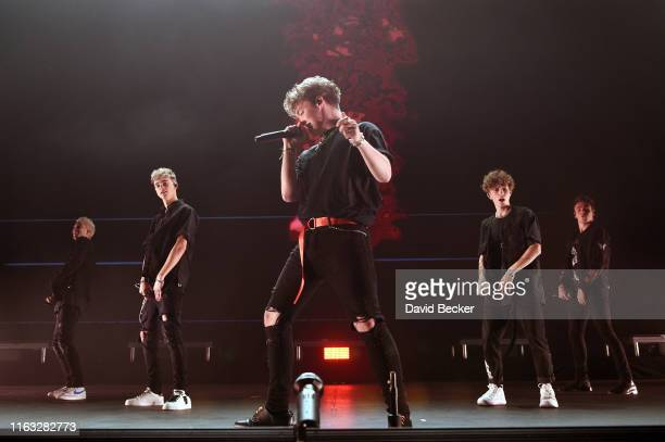Singers Corbyn Besson Daniel Seavey Zach Herron Jack Avery and Jonah Marais of Why Don't We perform at Park Theater at Park MGM on a stop of the pop...