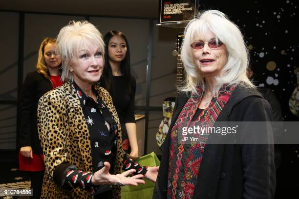 Singers Cyndi Lauper and Emmylou Harris attend the GRAMMY Gift Lounge during the 60th Annual GRAMMY Awards at Madison Square Garden on January 26...