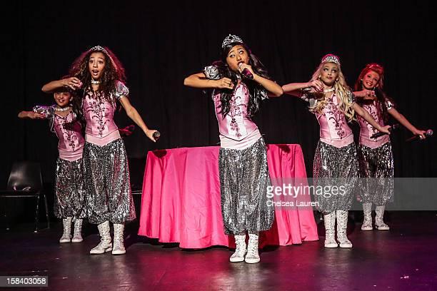 Singers / dancers Hailey Paolillo, Aspen Buck, Anna Villaranda, Jordyn Jones and Kyla Laufer of the 5 Little Princesses perform at the 5 Little...