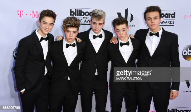Singers Daniel Seavey Jack Avery Corbyn Besson Zach Herron and Jonah Marais of Why Don't We arrive for the 2017 Billboard Music Awards at the TMobile...