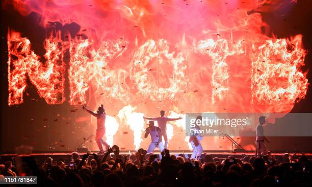 Singers Danny Wood Donnie Wahlberg Joey McIntyre Jonathan Knight and Jordan Knight of New Kids on the Block perform during a stop of the Mixtape Tour...