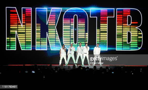 Singers Danny Wood Donnie Wahlberg Joey McIntyre Jordan Knight and Jonathan Knight of New Kids on the Block perform during a stop of the Mixtape Tour...