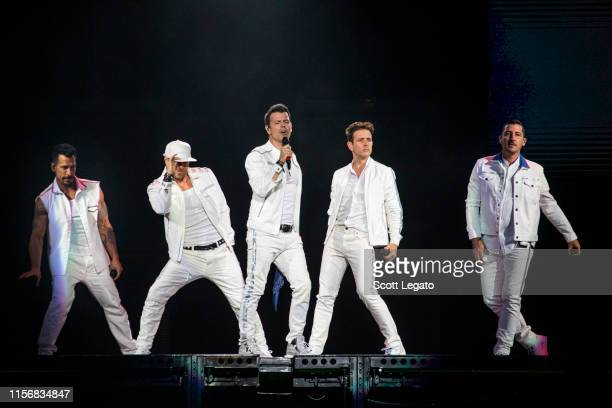 Singers Danny Wood Donnie Wahlberg Jordan Knight Joey McIntyre and Jonathan Knight of New Kids on the Block perform during a stop of the Mixtape Tour...