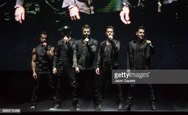 Singers Danny Wood Donnie Wahlberg Jordan Knight Joey McIntyre and Jonathan Knight of New Kids On The Block performs at Sprint Center on June 12 2017...