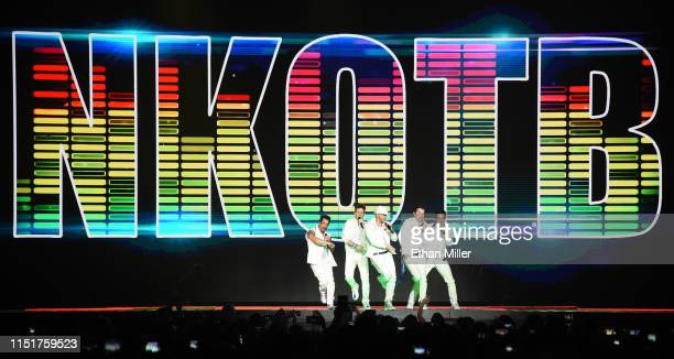 Singers Danny Wood Joey McIntyre Donnie Wahlberg Jordan Knight and Jonathan Knight of New Kids on the Block perform during a stop of the Mixtape Tour...