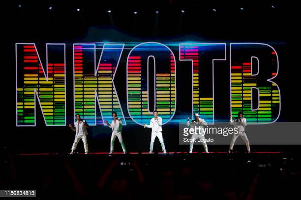 Singers Danny Wood Joey McIntyre Jordan Knight Donnie Wahlberg and Jonathan Knight of New Kids on the Block perform during a stop of the Mixtape Tour...