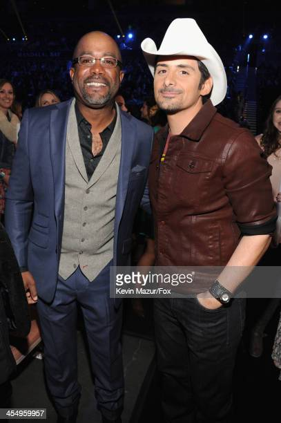 Singers Darius Rucker and Brad Paisley attend the American Country Awards 2013 at the Mandalay Bay Events Center on December 10, 2013 in Las Vegas,...
