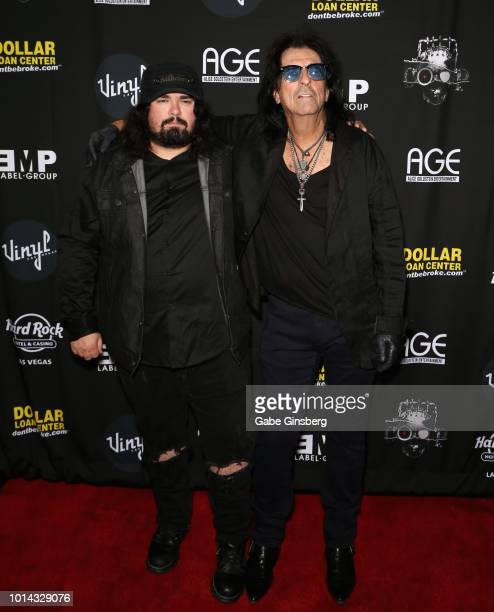 Singers Dash Cooper of COOP and his father Alice Cooper attend a CD release party for COOP at Vinyl inside the Hard Rock Hotel Casino on August 9...