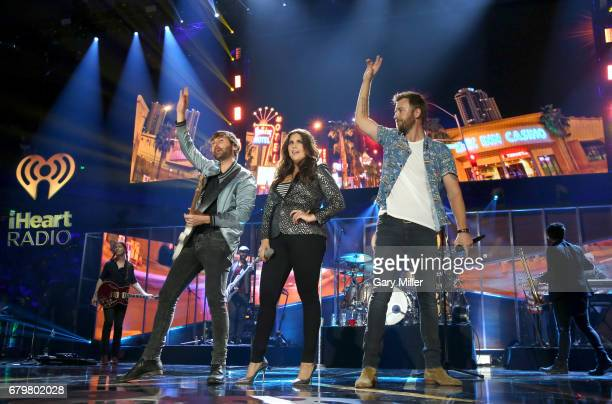 Singers Dave Haywood Hillary Scott and Charles Kelley of Lady Antebellum perform onstage during the 2017 iHeartCountry Festival A Music Experience by...