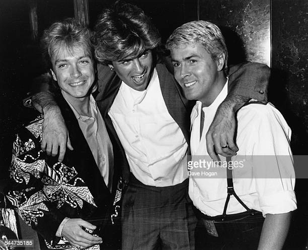 Singers David Cassidy, George Michael and Mike Nolan, at the premiere of the film 'Number One', London, April 22nd 1985.