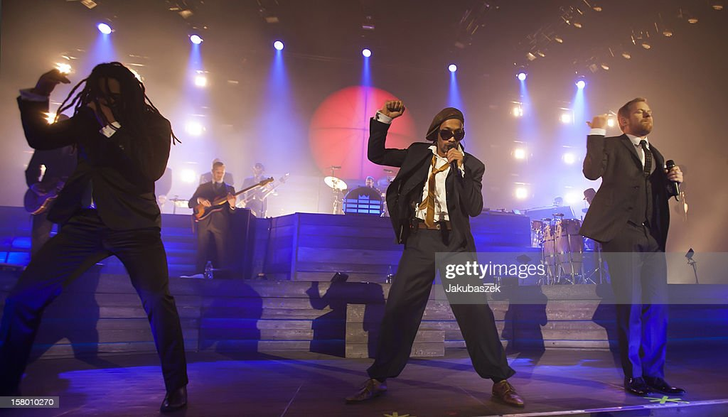 Singers Delle, Boundzound and Peter Fox of the German reggae band Seeed perform live during a concert at the Max-Schmeling-Halle on December 8, 2012 in Berlin, Germany.