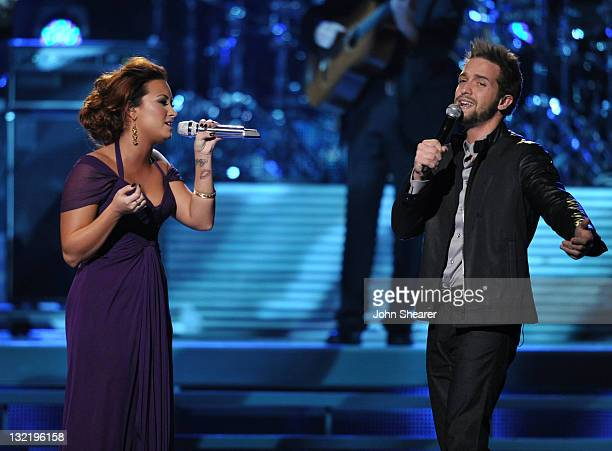 Singers Demi Lovato and Pablo Alboran perform onstage at the 12th Annual Latin GRAMMY Awards held at the Mandalay Bay Resort Casino on November 10...