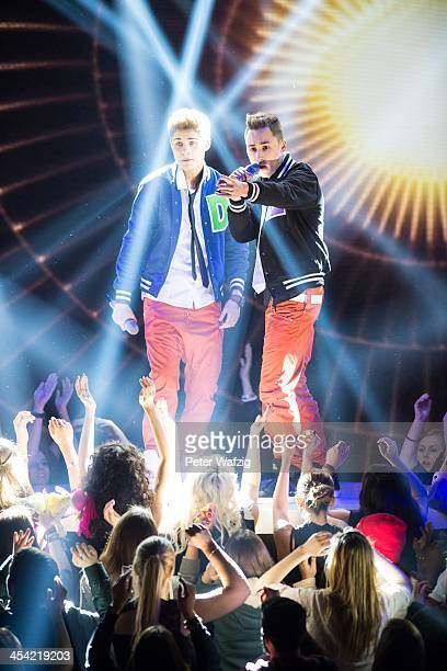 Singers Denny and Eiko perform during the second Semifinal of 'Das Supertalent' TV Show on December 07 2013 in Cologne Germany