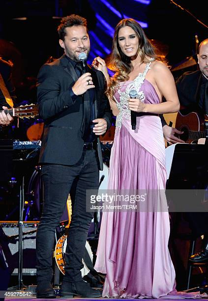 Singers Diego Torres and India Martinez perform onstage during the 2014 Person of the Year honoring Joan Manuel Serrat at the Mandalay Bay Events...
