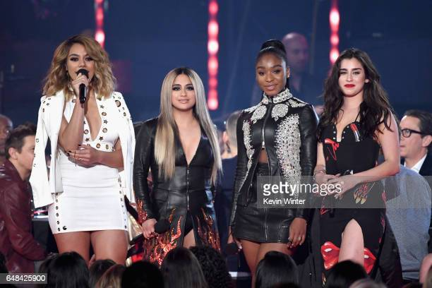 Singers Dinah Jane Ally Brooke Normani Kordei and Lauren Jauregui of Fifth Harmony speak onstage at the 2017 iHeartRadio Music Awards which broadcast...