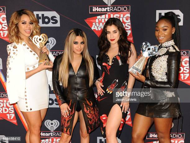 Singers Dinah Jane, Lauren Jauregui, Ally Brooke, and Normani Kordei of Fifth Harmony pose in the press room at the 2017 iHeartRadio Music Awards at...
