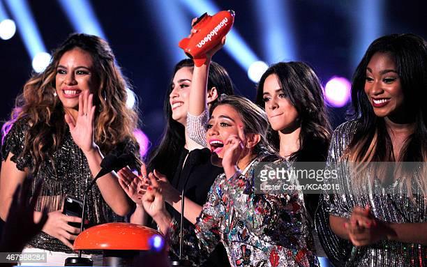 Singers DinahJane Hansen Lauren Jauregui Ally Brooke Camila Cabello and Normani Kordei of Fifth Harmony accept Favorite New Artist onstage during...