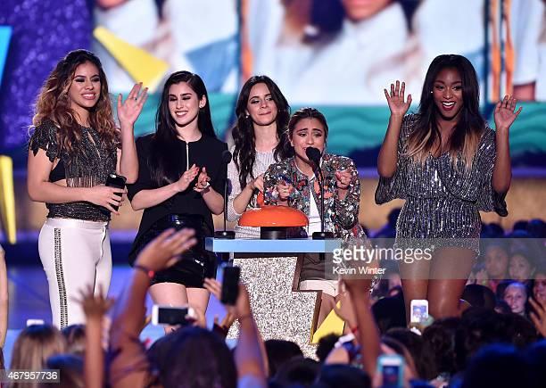 Singers DinahJane Hansen Lauren Jauregui Camila Cabello Ally Brooke and Normani Kordei of Fifth Harmony accept Favorite New Artist award onstage...