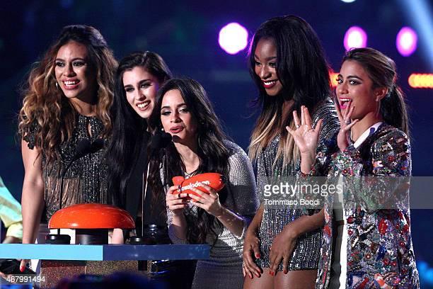 Singers Dinah-Jane Hansen, Lauren Jauregui, Camila Cabello, Ally Brooke and Normani Kordei of Fifth Harmony accept Favorite New Artist award onstage...