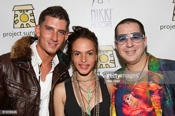 Singers Donnie Klang Alex Young and designer Noah G Pop attend Project Sunshine's John Legend performance at Nikki Beach on September 22 2009 in New...