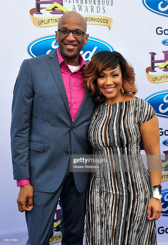 Singers Donnie McClurkin (L) and Erica Campbell attends the 2014 Ford Neighborhood Awards Hosted By Steve Harvey at the Phillips Arena on August 9, 2014 in Atlanta, Georgia.