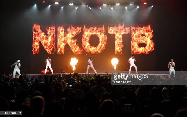 Singers Donnie Wahlberg Danny Wood Joey McIntyre Jonathan Knight and Jordan Knight of New Kids on the Block perform during a stop of the Mixtape Tour...