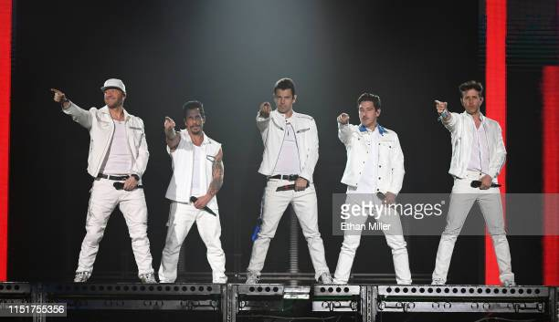 Singers Donnie Wahlberg, Danny Wood, Jordan Knight, Jonathan Knight and Joey McIntyre of New Kids on the Block perform during a stop of the Mixtape...
