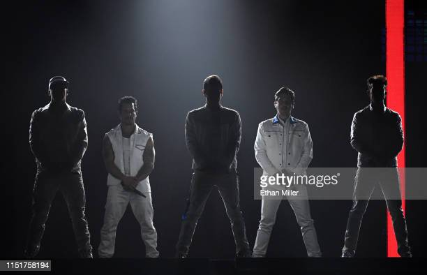 Singers Donnie Wahlberg Danny Wood Jordan Knight Jonathan Knight and Joey McIntyre of New Kids on the Block perform during a stop of the Mixtape Tour...