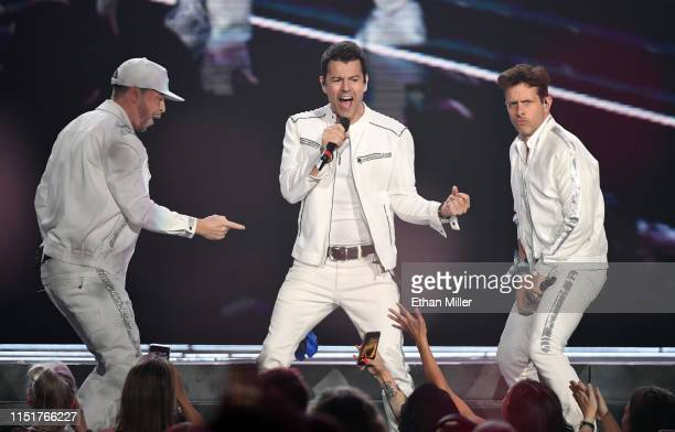 Singers Donnie Wahlberg Jordan Knight and Joey McIntyre of New Kids on the Block perform during a stop of the Mixtape Tour at the Mandalay Bay Events...