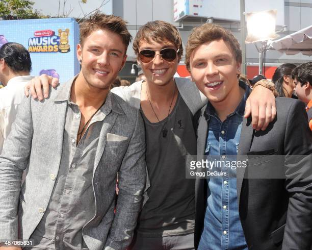 Singers Drew Chadwick Wesley Stromberg and Keaton Stromberg of Emblem3 arrive at the 2014 Radio Disney Music Awards at Nokia Theatre LA Live on April...