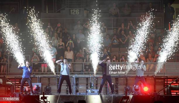 Singers Drew Lachey Nick Lachey Justin Jeffre and Jeff Timmons of 98 Degrees perform at the Mandalay Bay Events Center during The Package Tour on...