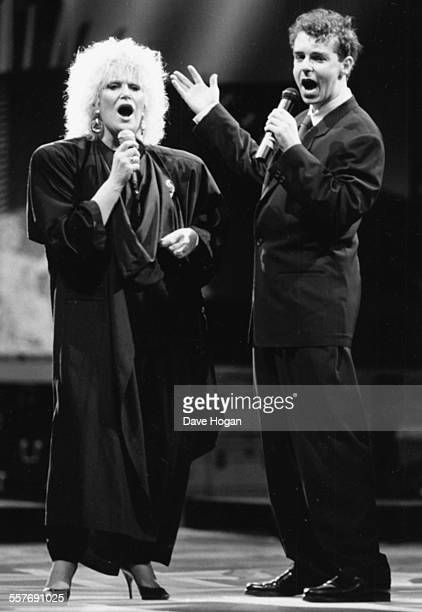 Singers Dusty Springfield and Neil Tennant of the band 'The Pet Shop Boys' performing together on stage at the British Rock Industry Awards London...